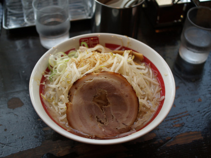 Bowl of Ramen with bean sprouts and a slice of pork